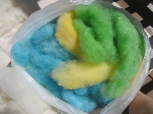 Hand carded and dyed wool, ready for felting