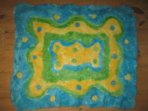 Voila. we can't wait to post here a picture of the newborn baby for whom we made this rug, who is due any day now.