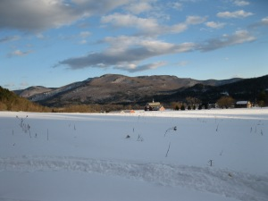 The world is still a snow bowl. View of Ewetopia Farm and the West Monitor Barn.